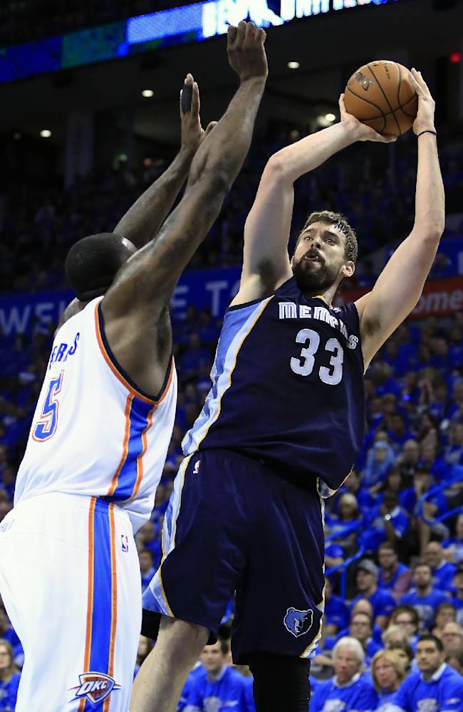 Memphis Grizzlies center Marc Gasol (33) shoots as Oklahoma City Thunder center Kendrick Perkins (5) defends during the second quarter of Game 1 of the opening-round NBA basketball playoff series in Oklahoma City on Saturday, April 19, 2014