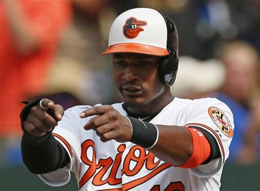 In this June 24, 2012, file photo, Baltimore Orioles' Adam Jones points to Matt Wieters after Wieters batted him in on a home run in the eighth inning ofan interleague baseball game against the Washington Nationals in Baltimore. For the first time since 1997, the Orioles are coming off a year that calls for an encore. After a run of 14 straight losing seasons, the Orioles went 93-69 in 2012 and beat the defending AL champion Texas Rangers in the wild-card. Now it's time to prove that sensational season wasn't just an aberration, but the start of something big in a city that has renewed its love for the long downtrodden Orioles