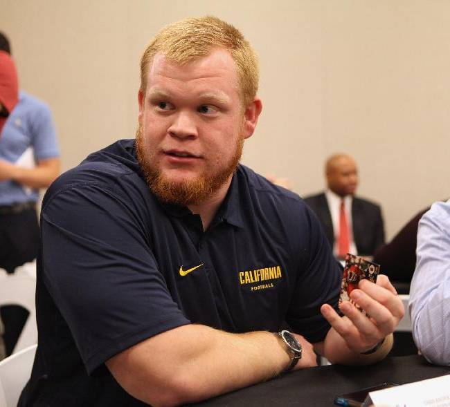 California center Chris Adcock takes questions from the media during the annual Bay Area college football media day at Levi's Stadium on Wednesday, July 30, 2014, in Santa Clara, Calif