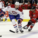 Montreal Canadiens left wing Drayson Bowman (96), left, controls the puck against Chicago Blackhawks center Brad Richards (91) during the first period of a preseason NHL hockey game in Chicago, Wednesday, Oct. 1, 2014. (AP Photo/Nam Y. Huh)