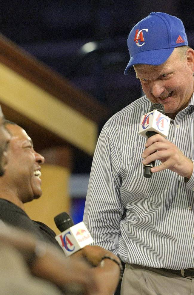 Steve Ballmer, right, the new owner of the Los Angeles Clippers, laughs with head coach Doc Rivers during a fan festival at the Staples Center in Los Angeles on Monday, Aug. 18, 2014