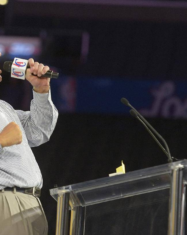 Steve Ballmer, the new owner of the Los Angeles Clippers, pumps up the crowd during a fan festival at the Staples Center, Monday, Aug. 18, 2014, in Los Angeles