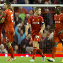 Liverpool's Dejan Lovren, second left, celebrates with teammates after scoring against Swansea during the English League Cup soccer match between Liverpool and Swansea at Anfield Stadium, Liverpool, England, Tuesday Oct. 28, 2014