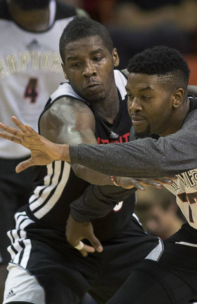 Dwight Buycks, left, and Julyan Stone battle for the ball during the Toronto Raptors' intrasquad NBA basketball game in Halifax, Nova Scotia, on Saturday, Oct. 5, 2013