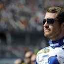Brian Vickers looks on before the NASCAR Sprint Cup Series auto race at Talladega Superspeedway Sunday, Oct. 19, 2014, in Talladega, Ala. (AP Photo/Rainier Ehrhardt)