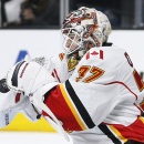 Calgary Flames goalie Joni Ortio makes a save against the Los Angeles Kings during the second period of an NHL hockey game, Monday, Jan. 19, 2015, in Los Angeles The Associated Press