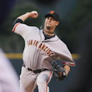 San Francisco Giants starting pitcher Ryan Vogelsong works against the Colorado Rockies in the first inning of a baseball game in Denver on Monday, April 21, 2014 The Associated Press