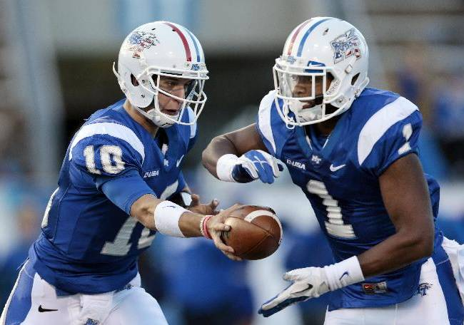 Middle Tennessee quarterback Logan Kilgore (10) hands off to running back Shane Tucker (1) in the first half of an NCAA college football game against Florida International on Saturday, Nov. 9, 2013, in Murfreesboro, Tenn