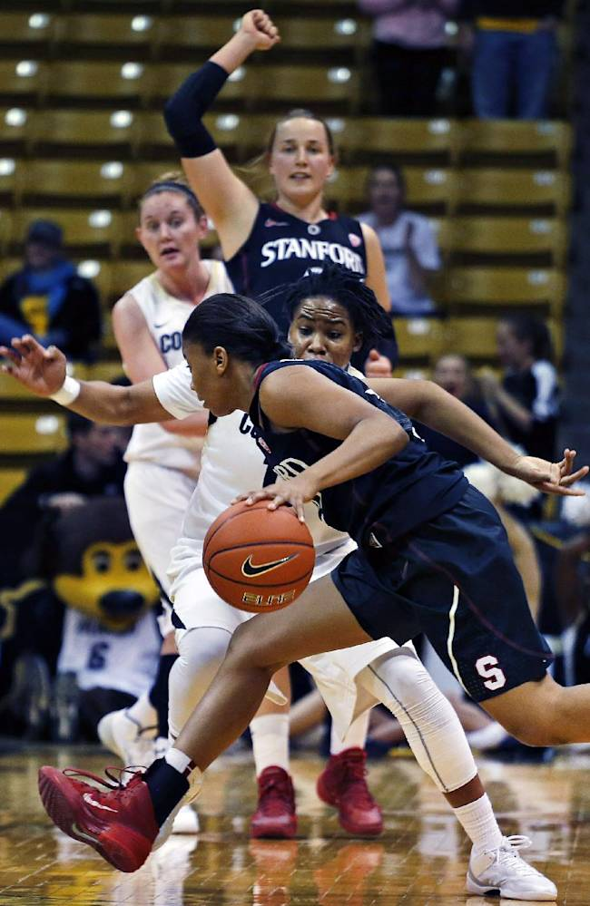 Stanford's Amber Orrange drives down court with the ball during the second half of an NCAA college basketball game against Colorado, in Boulder, Colo., Sunday, Jan. 12, 2014. Stanford went on to win 87-77