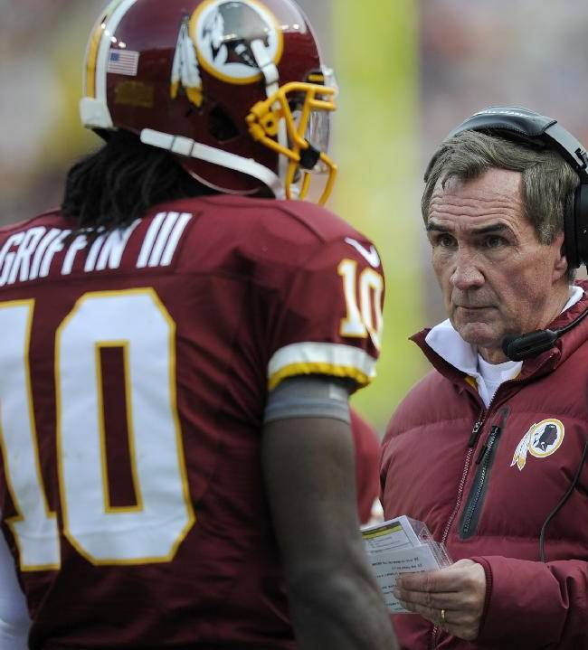 Washington Redskins head coach Mike Shanahan ranks with quarterback Robert Griffin III during the first half of an NFL football game against the Philadelphia Eagles in Landover, Md., Sunday, Nov. 18, 2012