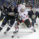 St. Louis Blues' Jori Lehtera (12) battles Ottawa Senators' Colin Greening (14) for the loose puck in front of St. Louis Blues goalie Brian Elliott (1) in the first period of a NHL hockey game, Tuesday, Nov. 25, 2014 in St. Louis The Associated Press