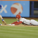 St. Louis Cardinals' Matt Holliday is tagged out at second base by New York Mets' Daniel Murphy, left, during the first inning of a baseball game Tuesday, April 22, 2014, in New York The Associated Press