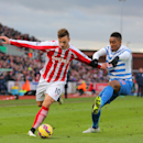 Stoke City's Marko Arnautovic, left, holds off Queens Park Rangers' Leroy Fer during their English Premier League soccer match at The Britannia Stadium, Stoke-on-Trent, England, Saturday, Jan. 31, 2015