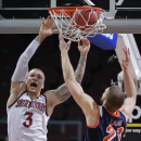 Saint Mary's Kerry Carter (3) dunks the ball against Pepperdine's Brendan Lane in the second half of a quarterfinal West Coast Conference NCAA college basketball tournament game, Saturday, March 8, 2014, in Las Vegas The Associated Press