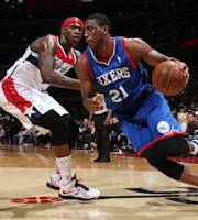 WASHINGTON, DC - NOVEMBER 1: Thaddeus Young #21 of the Philadelphia 76ers drives against Al Harrington #7 of the Washington Wizards during the game at the Verizon Center on November 1, 2013 in Washington, DC. (Photo by Ned Dishman/NBAE via Getty Images)