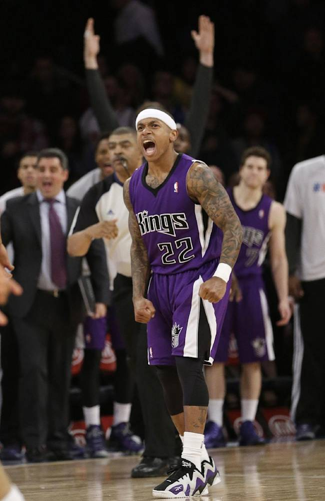 Sacramento Kings' Isaiah Thomas (22) reacts after scoring during overtime of an NBA basketball game against the New York Knicks Wednesday, Feb. 12, 2014, in New York. The Kings won 106-101