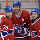 Montreal Canadiens' Andrei Markov, left to right, Max Pacioretty and David Desharnais celebrate a third period goal against the Ottawa Senators during NHL hockey action in Ottawa on Friday, April 4, 2014. Pacioretty scored a hat-trick helping the Canadien