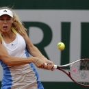Denmark's Caroline Wozniacki returns the ball to Britain's Laura Robson during their first round match of the French Open tennis tournament at the Roland Garros stadium Monday, May 27, 2013 in Paris. (AP Photo/Michel Spingler)