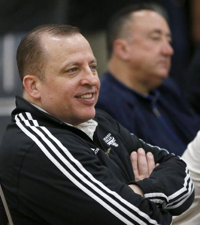 Chicago Bulls coach Tom Thibodeau, left, and general manager Gar Forman watch the first session at the 2014 NBA basketball Draft Combine Thursday, May 15, 2014, in Chicago