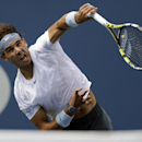 Rafael Nadal, of Spain, serves against Ivan Dodig, of Croatia, during the third round of the 2013 U.S. Open tennis tournament, Saturday, Aug. 31, 2013, in New York. (AP Photo/Mike Groll)
