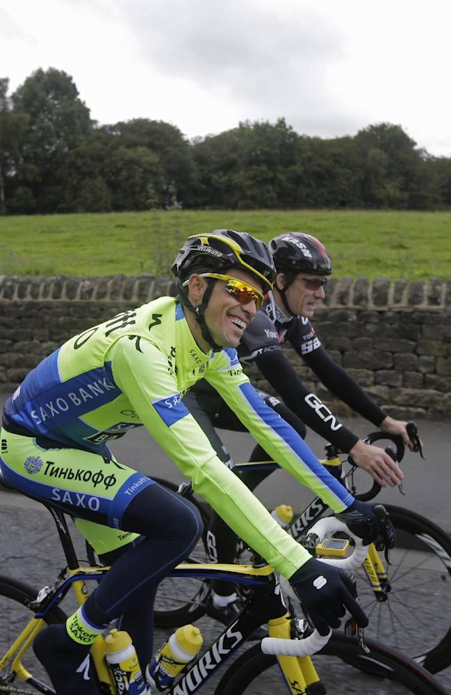 Spain's Alberto Contador, center, smiles during a training ride ahead of the Tour de France cycling race in Leeds, Britain, Thursday, July 3, 2014. The Tour de France will start on Saturday July 5 in Leeds, and finishes in Paris on Sunday July 27
