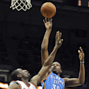 Milwaukee Bucks' Ekpe Udoh (5) defends as Oklahoma City Thunder's Kevin Durant (35) shoots during the first half of an NBA basketball game Saturday, Nov. 16, 2013, in Milwaukee The Associated Press