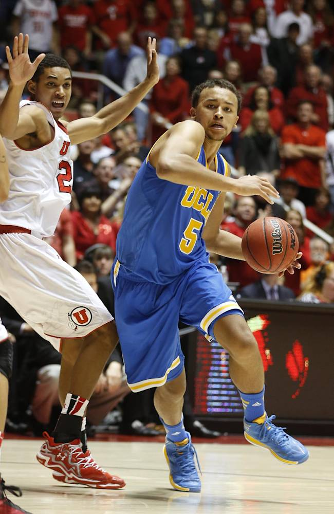 UCLA's Kyle Anderson, right, drives past Utah's Kenneth Ogbe during the second half of an NCAA college basketball game in Salt Lake City, Saturday, Jan. 18, 2014. Utah defeated UCLA 74-69