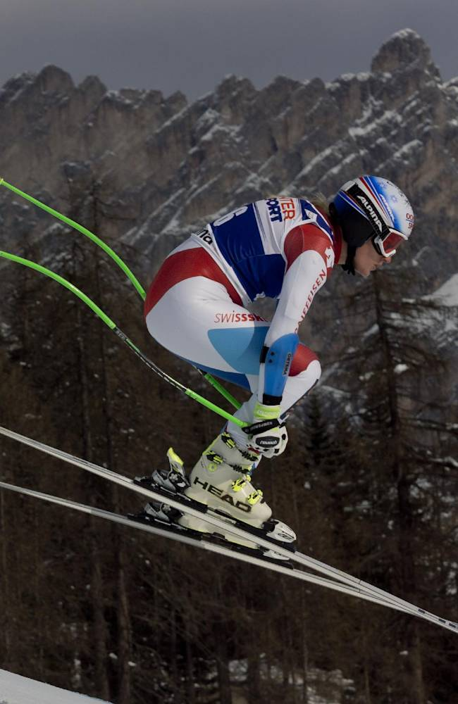 Switzerland's Denise Feierabend speeds down the course during an alpine ski, women's World Cup super-g, in Cortina D'Ampezzo, Italy, Thursday, Jan. 23, 2014. Feierabend placed 35th