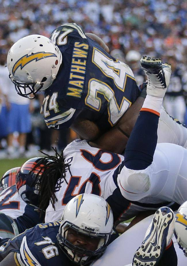 San Diego Chargers running back Ryan Mathews (24) goes over the top of the Denver Broncos defense to score a touchdown during the second half of a NFL football game Sunday, Nov. 10, 2013, in San Diego