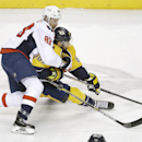 Washington Capitals center Jay Beagle (83) tries to slow down Nashville Predators' Mike Ribeiro, right, in the first period of an NHL hockey game Friday, Jan. 16, 2015, in Nashville, Tenn The Associated Press