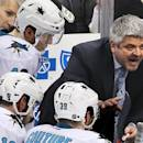 FILE - In this March 29, 2015, file photo, San Jose Sharks head coach Todd McLellan, center, talks to his team during a timeout in the third period of an NHL hockey game against the Pittsburgh Penguins in Pittsburgh. The Sharks announced Monday, April 20. 2015, that they had agreed to part ways with McLellan, the winningest coach in franchise history after the team missed the playoffs for the first time since 2003. (AP Photo/Gene J. Puskar, File)