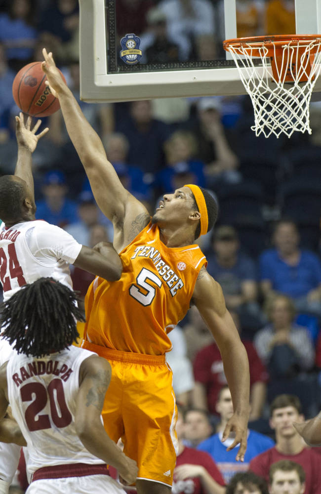 In this March 15, 2013, photo, Tennessee forward Jarnell Stokes defends against Alabama's Devonta Pollard during the Southeastern Conference basketball tournament in Nashville, Tenn. Stokes received some brutally honest feedback when he considered entering the NBA Draft after his sophomore season. He took that criticism to heart during the offseason by losing weight and developing a more well-rounded game