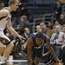 New Orleans Pelicans' Al-Farouq Aminu, right, and Milwaukee Bucks' Nate Wolters compete for a loose ball during the first half of an NBA basketball game Wednesday, Feb. 12, 2014, in Milwaukee The Associated Press