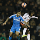 Fulham's Hugo Rodallega, right, vies for the ball with Sunderland's Liam Bridcutt during the English FA Cup fourth round replay soccer match between Fulham and Sunderland at Craven Cottage stadium in London, Tuesday, Feb. 3, 2015