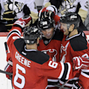 New Jersey Devils' Jaromir Jagr, of Czech Republic, celebrates his unassisted empty-net goal with Andy Greene, left, and Travis Zajac, right, during the third period of an NHL hockey game against the Pittsburgh Penguins, Saturday, Nov. 16, 2013, in Newark