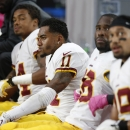 From left, Washington Redskins' Ryan Grant, DeSean Jackson, Pierre Garcon, and Roy Helu sit on the bench late in the second half of an NFL football game loss to the against the Arizona Cardinals Sunday, Oct. 12, 2014, in Glendale, Ariz. The Cardinals def