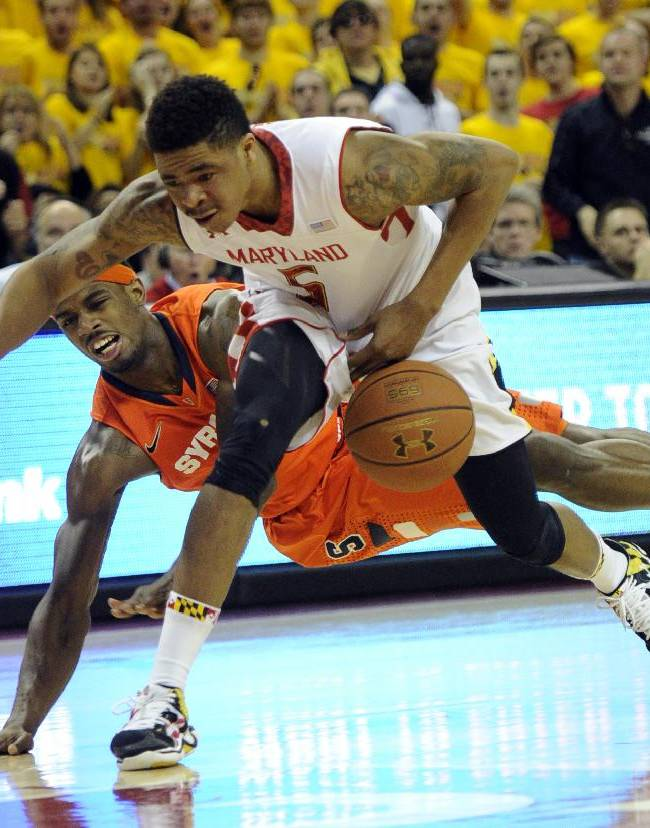 Syracuse forward C.J. Fair, left, fights for the ball against Maryland guard Nick Faust (5) during the second half of an NCAA college basketball game, Monday, Feb. 24, 2014, in College Park, Md. Fair was called for a foul on the play. Syracuse won 57-55