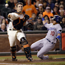 San Francisco Giants catcher Buster Posey throws to first base to complete a double play after putting out Los Angeles Dodgers' Justin Turner (10) on a ground ball by Juan Uribe during the seventh inning of a baseball game on Wednesday, April 16, 2014, in