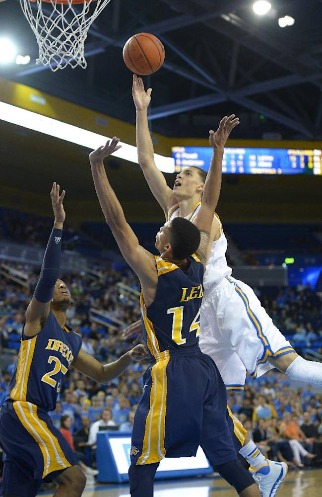 UCLA guard Zach LaVine, right, puts up a shot as Drexel guard Major Canady, left, and guard Damion Lee defend during the second half of an NCAA college basketball game, Friday, Nov. 8, 2013, in Los Angeles. UCLA won 72-67