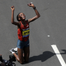 FILE - In this Monday, April 21, 2014 file photo, Rita Jeptoo of Kenya celebrates her win in the women's division of the 118th Boston Marathon in Boston. Athletics Kenya said on Friday, Jan. 30, 2015 that it has banned marathon champion Rita Jeptoo two years for doping after traces of the banned blood-booster EPO were found in her out-of-competition test in Kenya on Sept. 25. (AP Photo/Charles Krupa, File)