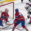 Dallas Stars' Patrick Eaves scores past Montreal Canadiens goalie Carey Price as Canadiens' Tom Gilbert (77) and Tomas Plekanec (14) defend during the second period of an NHL hockey game Tuesday, Jan. 27, 2015, in Montreal. (AP Photo/The Canadian Press, Paul Chiasson)