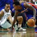 Detroit Pistons point guard Brandon Jennings (7) controls the ball as Boston Celtics point guard Avery Bradley falls to the floor in the second half of an NBA basketball game in Boston, Wednesday, Dec. 18, 2013. The Pistons won 107-106. (AP Photo/Elise Amendola)