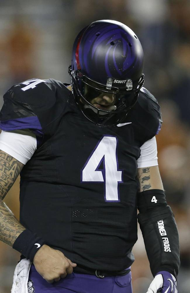 TCU quarterback Casey Pachall (4) hangs his head as he head back to the sideline after throwing a third down incomplete pass during the second half on an NCAA college football game against Texas  Saturday, Oct. 26, 2013, in Fort Worth, Texas