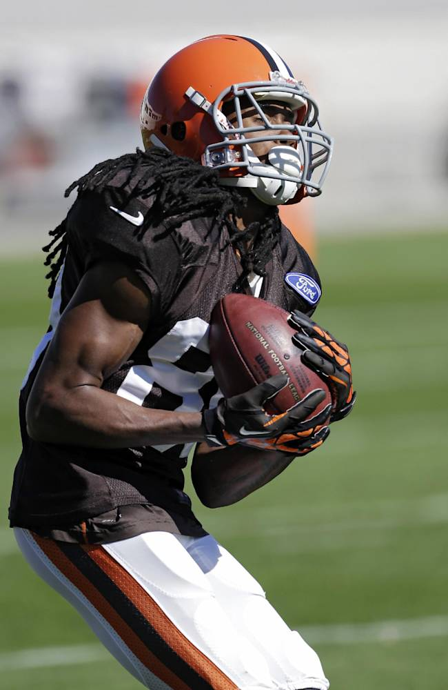 In this photo taken on Wednesday, Oct. 9, 2013, Cleveland Browns' Travis Benjamin fields a punt during NFL football practice at the team's facility in Berea, Ohio. There's fast and then there's Benjamin, the Browns' fleet-footed punt returner who took one back 79 yards for a touchdown last week and earned his