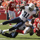 Kansas City Chiefs tight end Anthony Fasano (80) is tackled by Tennessee Titans safety Bernard Pollard (31) and safety Michael Griffin in the second half of an NFL football game in Kansas City, Mo., Sunday, Sept. 7, 2014 The Associated Press