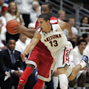 Arizona's Nick Johnson (13) tries to steal the ball away from UNLV's Kevin Olekaibe in the first half of an NCAA college basketball game on Saturday, Dec. 7, 2013, in Tucson, Ariz. (AP Photo/John MIller)