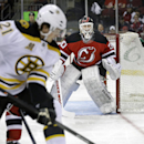 New Jersey Devils goalie Martin Brodeur (30) watches as Boston Bruins' Loui Eriksson (21), of Sweden, works the puck near the goal during the first period of an NHL hockey game in Newark, N.J., Sunday, April 13, 2014 The Associated Press