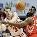 Chicago Bulls guard Mike Dunleavy, left, and Houston Rockets guard James Harden watch the ball after Dunleavy passed it during the first half of an NBA basketball game in Chicago on Thursday, March 13, 2014. (AP Photo/Nam Y. Huh)