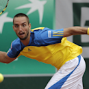 Serbia's Viktor Troicki returns the ball to France's Jo-Wilfried Tsonga during their fourth round match of the French Open tennis tournament at the Roland Garros stadium Sunday, June 2, 2013 in Paris. (AP Photo/Christophe Ena)