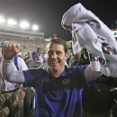 Florida head coach Will Muschamp celebrates in front of fans as he leaves the field after defeating Florida State 37-26 in an NCAA college football game, Saturday, Nov. 24, 2012, in Tallahassee, Fla. (AP Photo/John Raoux)